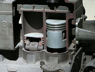 Piston - Pistons within a sectioned petrol engine