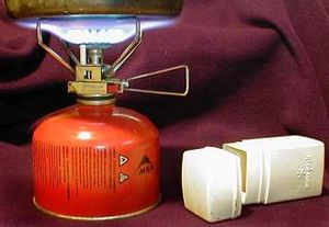 Survival kit - A small Snow Peak portable stove running on MSR gas and the stove's carrying case