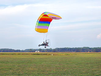 Powered parachute - Side view in flight.