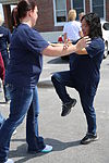 Premier Martial Arts instructs Cherry Point volunteers on basic self-defense 140610-M-GY210-298.jpg