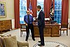 President Barack Obama talks with New York Times photojournalist Joao Silva.jpg