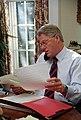 President Bill Clinton talks on the telephone regarding Kosovo in the Oval Office Dining Room.jpg