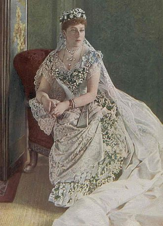 Wedding dress of Princess Beatrice - Princess Beatrice in her wedding dress, Osborne, 1885. Beatrice wore her mother's wedding veil of Honiton lace.