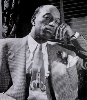 James F. Jones (minister) - Prophet Jones wearing a double-breasted cut zoot-suit and $100 hand-painted cravat with ecclesiastical motif