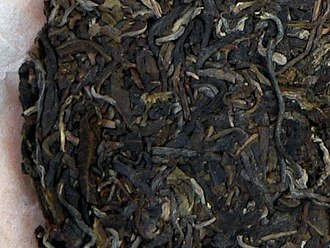 Pu'er tea - Relatively young raw pu'er; note the grey and dark green tones