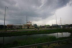 QL1A doan qua Huyen Binh Chanh.jpg