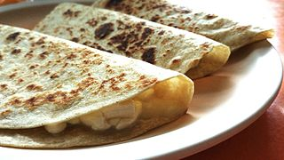 Quesadilla Mexican dish consisting of a tortilla filled with cheese and then grilled