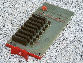 Flip chip - Digital Equipment Corp. R107 Flip Chip module from 1967; this board holds 8 hybrid integrated circuits built using flip-chip technology.  These, plus 7 discrete transistors and 14 discrete diodes combine to make 7 inverters.