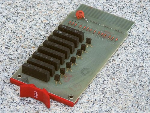 Digital Equipment Corp. R107 Flip Chip module from 1967; this board holds 8 hybrid integrated circuits built using flip-chip technology. These, plus 7 discrete transistors and 14 discrete diodes combine to make 7 inverters. R107FlipChipTop.JPG