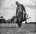 RAF Debden - 4 FG pilot with Mascott.jpg
