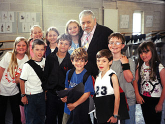 "Robert B. Sherman - Original London cast - ""Janes and Michaels"". Left to right (Front): Poppy Lee Friar, Jack Montgomery, Perry Millward, Harry Stott, Ben Watton, Jake Catterall, Nicola Bowman.  Left to right (BACK): Charlotte Spencer, Faye Spittlehouse, Carrie Hope Fletcher, Robert B. Sherman. (Photo Date: 19 July 2004)"