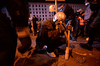 Radically oriented masked protester weaponed with bat preparing for attack. Dynamivska str. Euromaidan Protests. Events of Jan 19, 2014.jpg