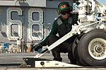 Readying a Super Hornet for launch DVIDS102127.jpg