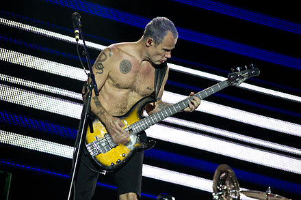 Bassist Flea playing bass with slapping technique Red Hot Chili Peppers - Rock in Rio Madrid 2012 - 11.jpg