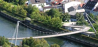 Schlaich Bergermann Partner - Kelheim bridge across the Main-Danube Canal uses a one-sided suspension bridge architecture