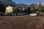 Riebeeck Square - one of the squares round which Cape Town developed. It was first known as Boeren-plein, and later as Hottentot Square. Here the farmers outspanned their wagons and off-loaded their products. During the seventeenth century Cape Town expanded for the most part from the sea towards Table Mountain along the axis of the Heerengracht or Adderley Street. During the eighteenth century it expanded laterally also, and began to fill Table Valley. Type of site: Square.