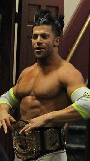 The BroMans - Robbie E as the TNA World Tag Team Champion in December 2013.