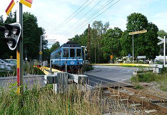 Djursholmsbanan - A modern train at the railway crossing of Bråvallavägen, just south of Altorp station in 2012.