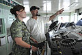 Royal Canadian Navy Lt. Terri McTavish receives shipboard navigational training at the helm from civilian mariner Tom Simmonson, right, while navigating the hospital ship USNS Mercy (T-AH 19) after completing 120827-N-KW566-003.jpg