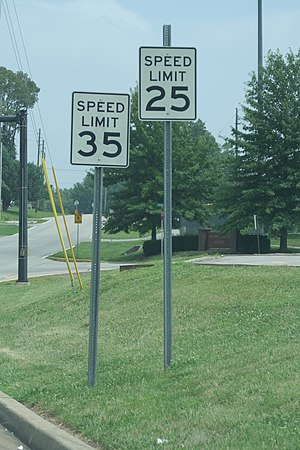 An image of two contradictory speed limit signs.