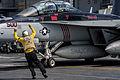 Sailor directs an E-A-18G aboard USS George Washington. (10193352754).jpg