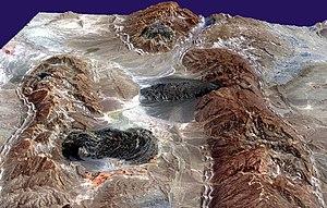 Salt glacier - Salt domes (hills) and salt glaciers (dark areas) in the Zagros Mountains of southern Iran.