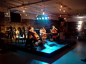 """Ottawa Chamberfest - The Samurai String Quartet played covers of 90's grunge music, old Nintendo video games and television theme songs. This particular picture shows them playing """"I'm Shipping Off to Boston"""" by the Dropkick Murphy's. The Quartet played until they were asked to leave at 2 am."""