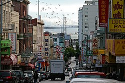 Chinatown businesses line Jackson Street, with the Bay Bridge in the foreground.