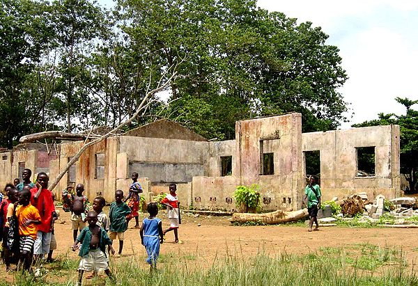 A school in Koindu destroyed during the Civil War; in total 1,270 primary schools were destroyed in the War. School destroyed by Sierra Leone Civil War.jpg
