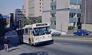 Seattle AM General trolleybus climbing James St near 5th Ave in 1983