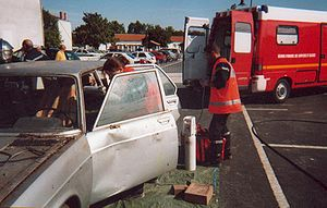 Vehicle extrication - Public demonstration; the ambulance team take care of the casualty inside the stabilised vehicle — Sainte-Soulle, France, September 2001