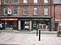 Shops beside Clock Tower, Morpeth - geograph.org.uk - 2131003.jpg
