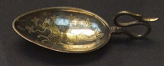 Cignus - Silver-gilt cignus spoon with a bird-headed handle and bowl decorated with a mythical marine creature.  4th century CE from the Hoxne Hoard