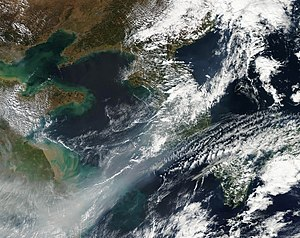 "Haze - A weak cold front, associated with smog, in the Yellow Sea. The cold front, while moving south, picked up the smog from eastern China into a ""smog front"""