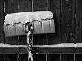 Snow shovel, rear, against wooden fence.jpg