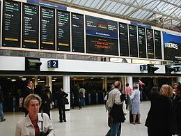 Solari departure boards at London Charing Cross station, 2002.jpg
