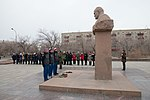 Soyuz MS-11 backup crew at the statue of Sergey Korolev.jpg
