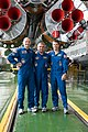 Soyuz TMA-13M crew in front of their booster rocket.jpg