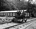 Speeder with three women and one man in front of bunkhouse, Brighton Mills Company, Brighton, ca 1922 (KINSEY 2146).jpeg