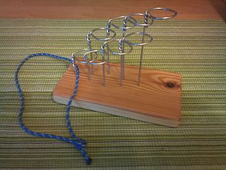 Disentanglement puzzle - A complex disentanglement puzzle. The goal is to free the string.