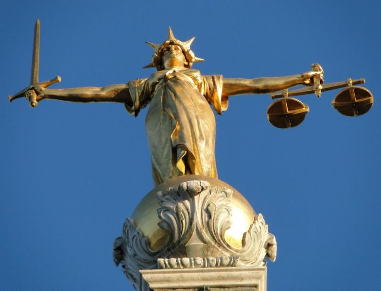 Old Bailey, Lady Justice, with a set of scales suspended from one hand and a double-edged sword in her other.