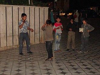 Children's street culture - Young boys playing in a sidewalk, 2013, Tehran