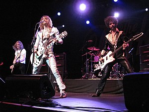 The Darkness (band) - Left-to-right: Dan and Justin Hawkins and Frankie Poullain (obscured: Ed Graham), performing at Terminal 5 in New York on 21 October 2012
