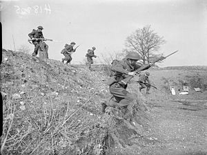53rd (Welsh) Infantry Division - With bayonets fixed, men of the 7th Battalion, Royal Welch Fusiliers charge down a bank on an assault course at Teddesley Hall, Penkridge in Staffordshire, England, 27 March 1942.