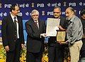 The Chief Justice of India Shri P. Sathasivam presenting the Life Time Achievement award to Shri. Rajesh Bedi at the 3rd National Photo Award 2012 in New Delhi. The Secretary, Ministry of Information & Broadcasting.jpg