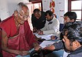 The Polling official administering indelible ink at the finger of a monk at a polling booth near Thiksey Monastery in Ladakh during the 5th and final phase of General Election-2009, in J&K on May 13, 2009.jpg