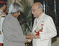 The President, Dr. A.P.J. Abdul Kalam presenting the Padma Bhushan Award – 2006 to a well-known stage and film actor Shri. A.K. Hangal, in New Delhi on March 20, 2006.jpg