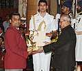 The President, Shri Pranab Mukherjee presenting the Arjuna Award for the year-2016 to Shri Rajat Chauhan for Archery, in a glittering ceremony, at Rashtrapati Bhavan, in New Delhi on August 29, 2016.jpg