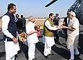 The Prime Minister, Shri Narendra Modi being welcomed by the Chief Minister of Gujarat, Shri Vijay Rupani and other dignitaries, on his arrival, at Deesa Helipad, in Ahmedabad, Gujarat on December 10, 2016.jpg