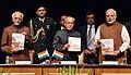 """The Prime Minister, Shri Narendra Modi releasing a book entitled """"Rashtrapati Bhavan Raj to Swaraj"""", at Rashtrapati Bhavan, in New Delhi.jpg"""
